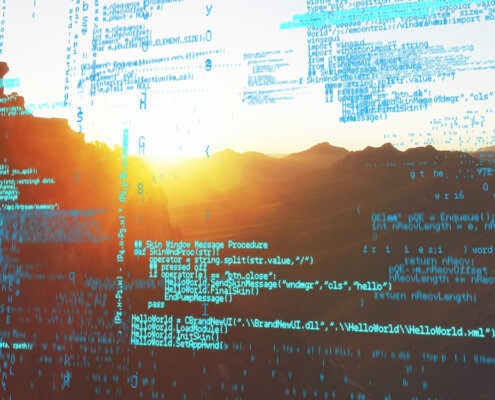 software code superimposed over mountains