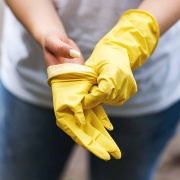 non profit volunteer putting on a pair of gloves