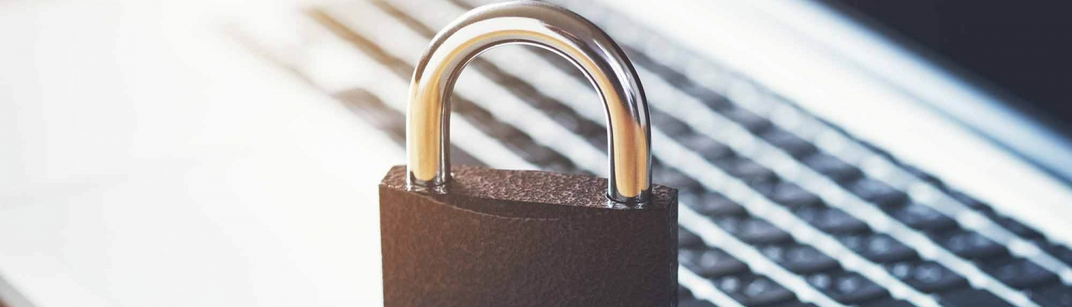 Lock sitting on top of laptop Cybersecurity July Blog 1