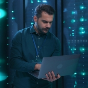 IT specialist reviews and conducts reports on servers health